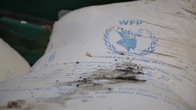 yemen's huthi rebels destroy a consignment of food aid bearing the logo of the world food programme for the war-torn country on the brink of famine - charity and relief work stock videos & royalty-free footage
