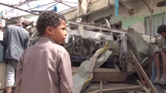 yemen's saada residents react to the bus attack that killed 29 children on a bus - yemen stock videos & royalty-free footage