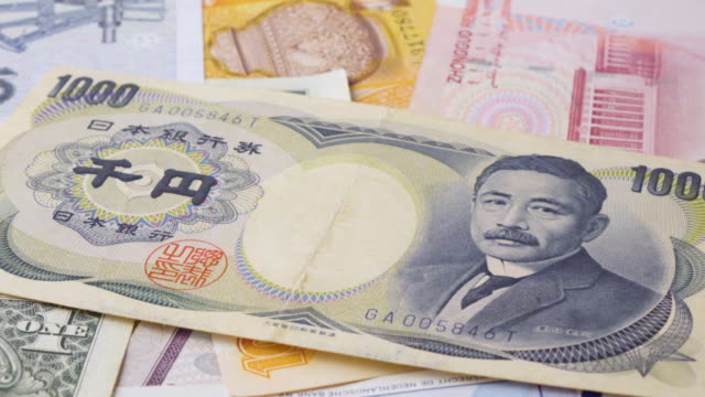Yen Banknote Turning 2 Clips In 1 Stock Footage Slow & Fast.