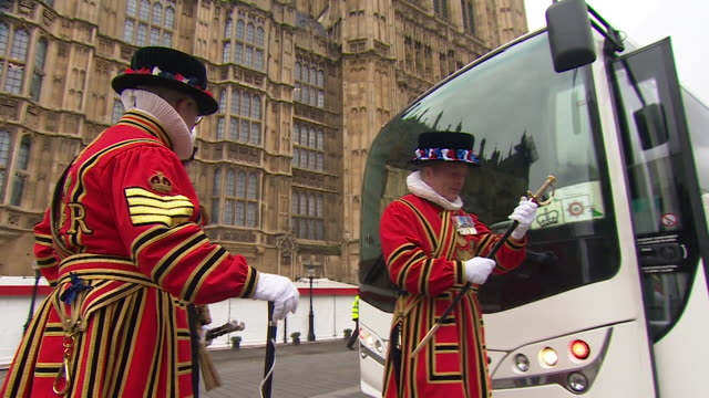yeoman of the guard get on coach outside houses of parliament after the queen's speech at the state opening of parliament - tradition stock videos & royalty-free footage