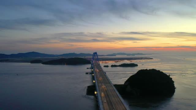yeongjong grand bridge and incheon international airport expressway at sunset / seo-gu, incheon, south korea - motorway stock videos & royalty-free footage