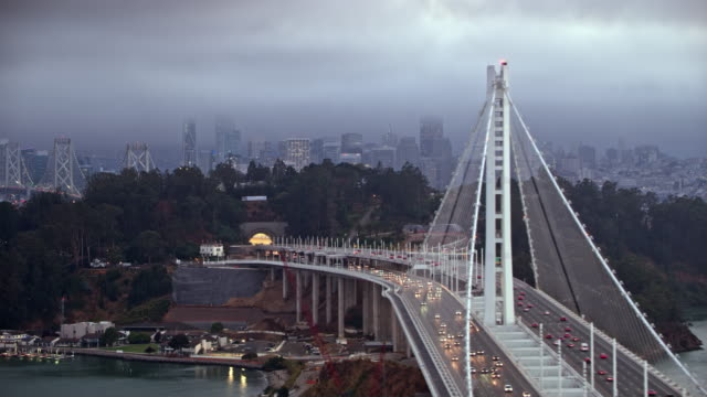 aerial yerba buena island overlooking the san francisco city in dusk - panning stock videos & royalty-free footage