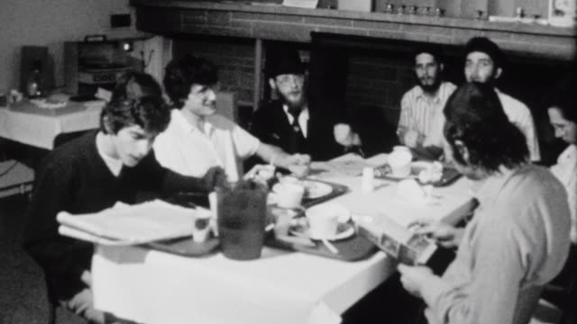 stockvideo's en b-roll-footage met yeshiva students sing a song about zion at the chabad house at the university of washington / yeshiva students singing niggun on october 01 1975 in... - universiteit van washington