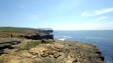 stockvideo's en b-roll-footage met yesnaby is an area in sandwick, on the west coast of orkney mainland, scotland, south of skara brae - klif