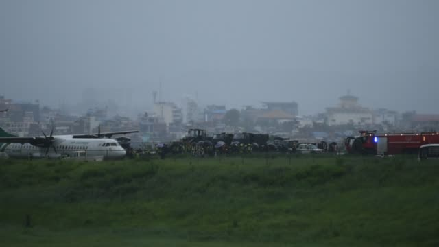 yeti airlines plane skidded off during landing at tribhuwan international airport, kathmandu, nepal on friday, july 12, 2019. - kathmandu stock videos & royalty-free footage