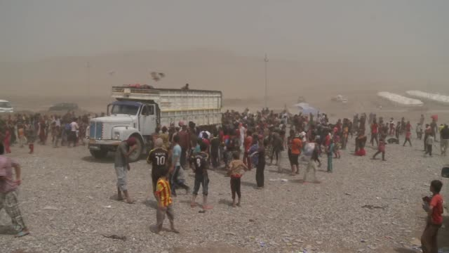 yezidi refugees collect supplies thrown from truck in northern iraq during isil conflict in 2014 - isil conflict stock videos & royalty-free footage