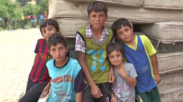 yezidis fleeing sinjar town of mosul due to the attacks of islamic stateled armed groups take shelter at a local primary school in ortasu village of... - sinjar stock videos & royalty-free footage