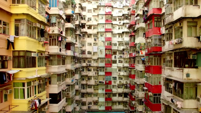 yick cheong buildings, quarry bay, hong kong by drone - terra brulla video stock e b–roll