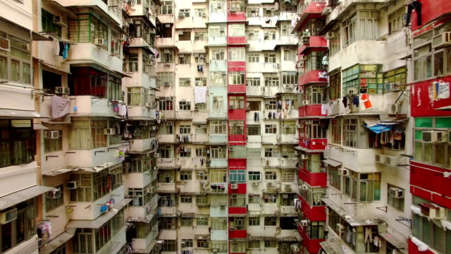 yick cheong buildings, quarry bay, hong kong by drone - povertà video stock e b–roll