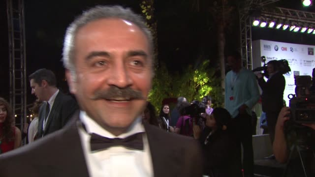 interview yilmaz erdogan on his return to dubai promoting the film and working with russell crowe at 'the water diviner' red carpet 11th annual dubai... - russell crowe stock videos & royalty-free footage
