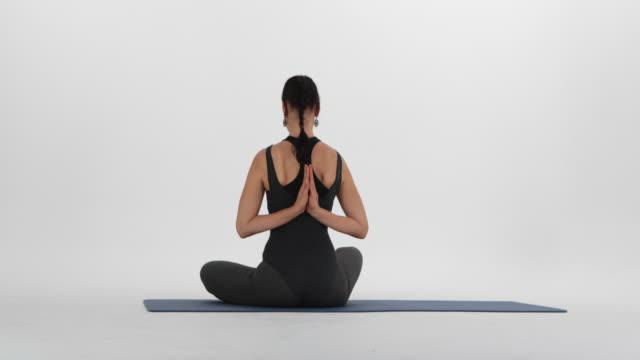 yoga asana, ardha padmasana exercise, half lotus pose - prayer position stock videos & royalty-free footage