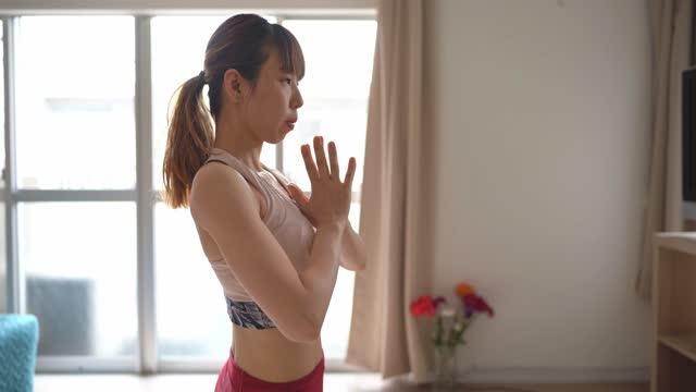 yoga at home, asian woman - human limb stock videos & royalty-free footage