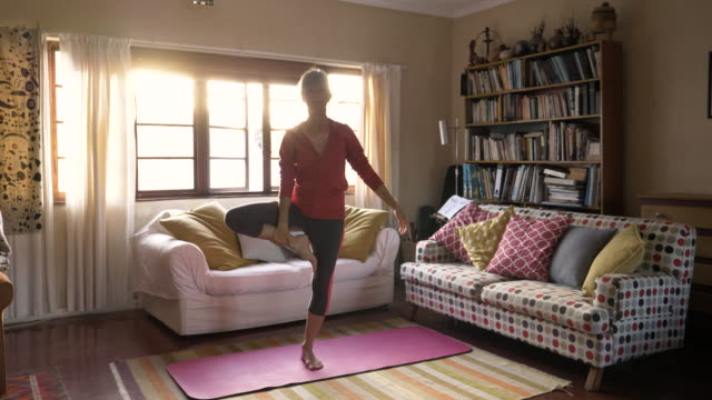 yoga at home - early morning exercise stock videos & royalty-free footage