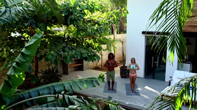 yoga at our luxury holiday villa - costa rica stock videos & royalty-free footage