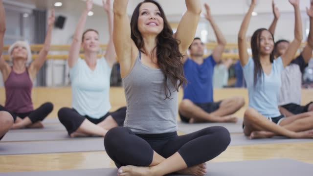 yoga class of adults - 40 44 years stock videos & royalty-free footage