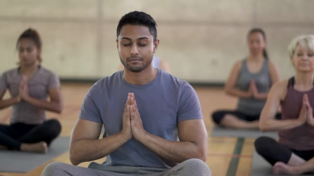 yoga class prayer pose - zen like stock videos & royalty-free footage