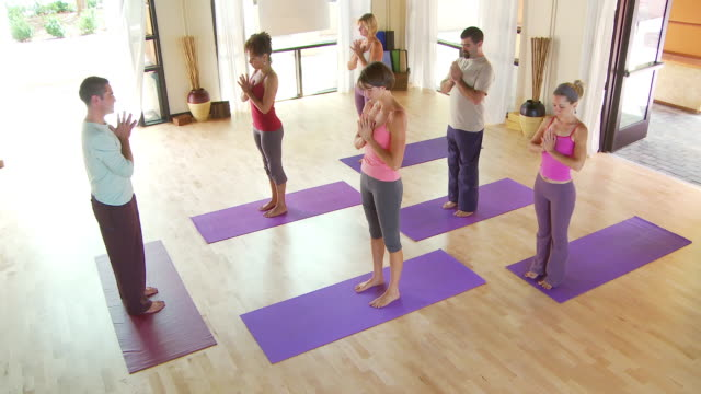 yoga class - mountain pose stock videos and b-roll footage