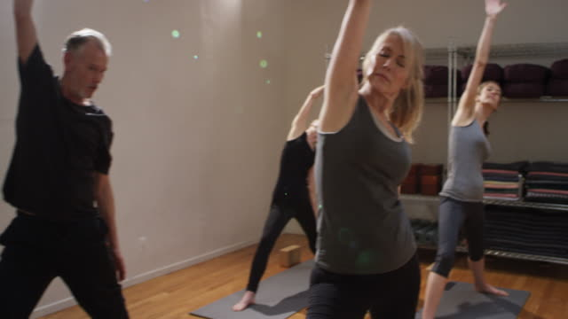 Yoga class with healthy older adults and retired people in a studio