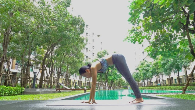 yoga concept; young woman doing yoga exercise - harmony stock videos & royalty-free footage
