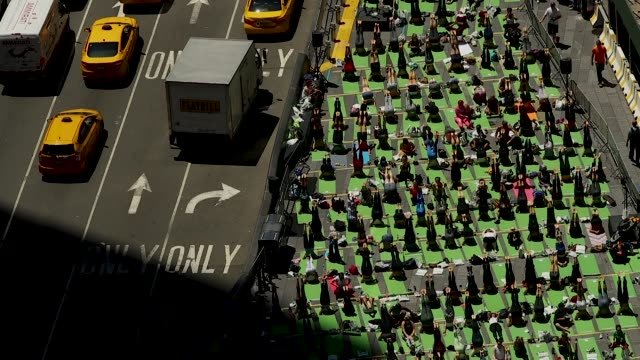 yoga enthusiasts participate in a mass yoga class in manhattan's times square to celebrate the summer solstice and mark world yoga day june 21 2018... - summer solstice stock videos and b-roll footage