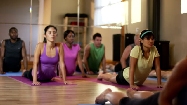 yoga fitness class - group of objects stock videos & royalty-free footage