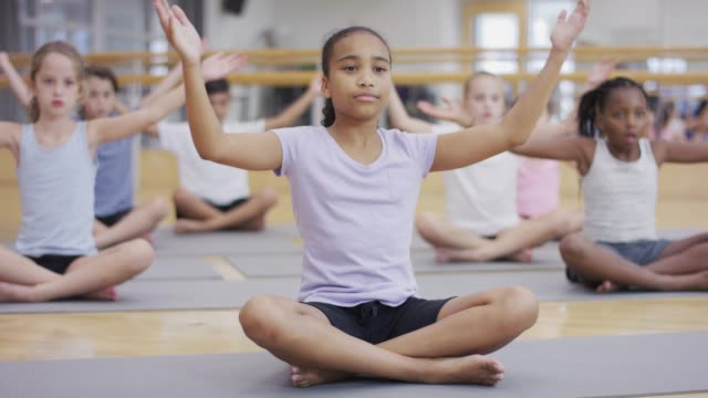 yoga for kids - girl cross legged stock videos & royalty-free footage