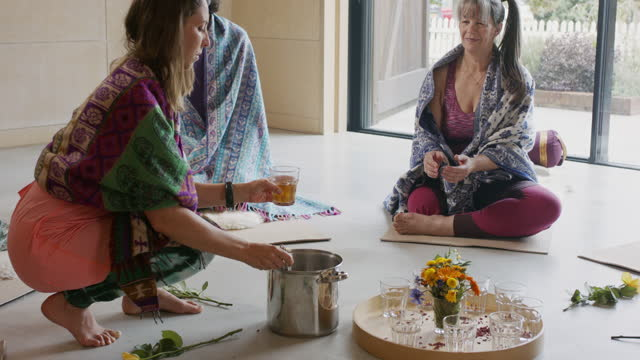 yoga instructor preparing tea ritual in yoga class - respect stock videos & royalty-free footage