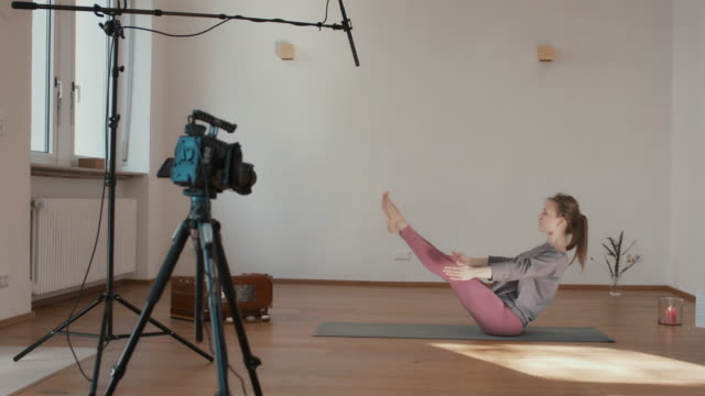 yoga instructor recording lesson alone in studio - net sports equipment stock videos & royalty-free footage