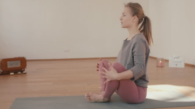 yoga instructor recording lesson alone in studio - tutorial stock videos & royalty-free footage