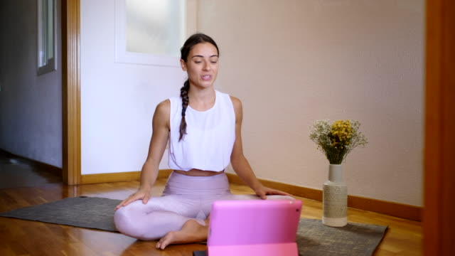 yoga instructor ussing a digital tablet to broadcast a training lesson - hot pink stock videos & royalty-free footage