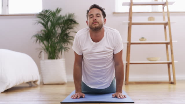 yoga is a natural part if his lifestyle - relaxation exercise stock videos & royalty-free footage