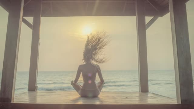 yoga meditation at sunset - fantasy stock videos & royalty-free footage