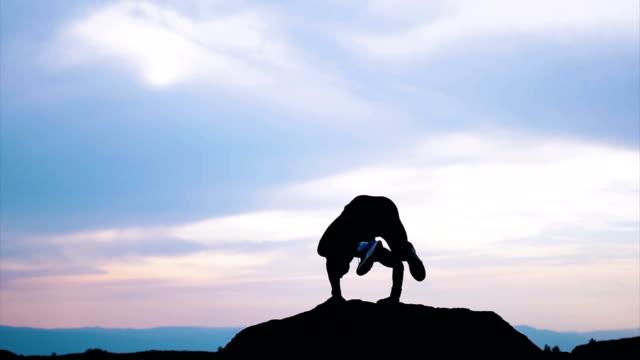 Yoga on mountain in sunset