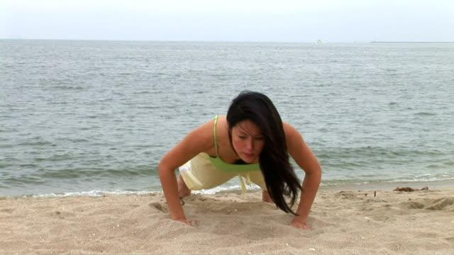 yoga on the beach - sun salutation stock videos and b-roll footage