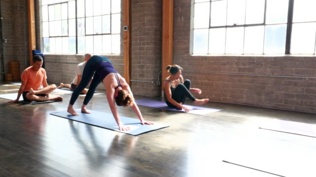 MS PAN Yoga students in various poses during class in studio