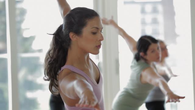 MS TD Yoga students practicing yoga in yoga studio / Vancouver, British Columbia, Canada