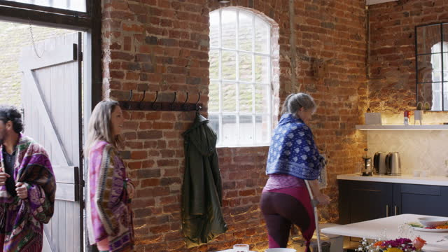 yoga students walking through doorway of rustic cafe for lunch - dining room stock videos & royalty-free footage