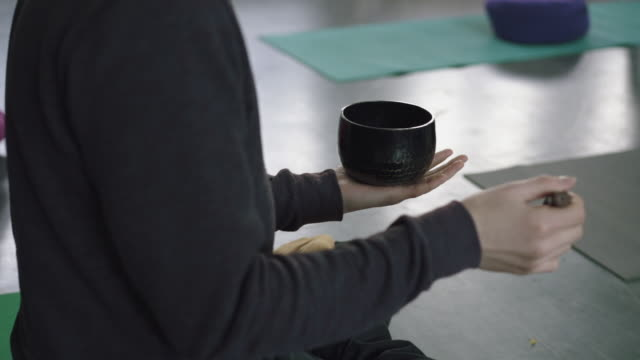 yoga teacher uses sound bowl - exercise equipment stock videos & royalty-free footage