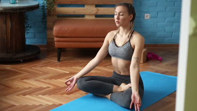 yoga - lotus position stock videos & royalty-free footage