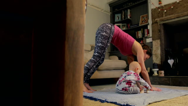 yoga with mum - multitasking stock videos & royalty-free footage