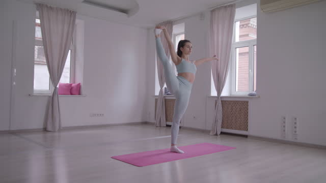 yoga woman stretching poses in a dance studio. - slow motion - dance studio stock videos & royalty-free footage
