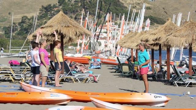 yoga/pilates stretch class on the beach at skala eresou, on lesbos, greece. - pilates stock videos & royalty-free footage