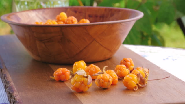 yoghurt and cloudberries served in the garden - freshness stock videos & royalty-free footage