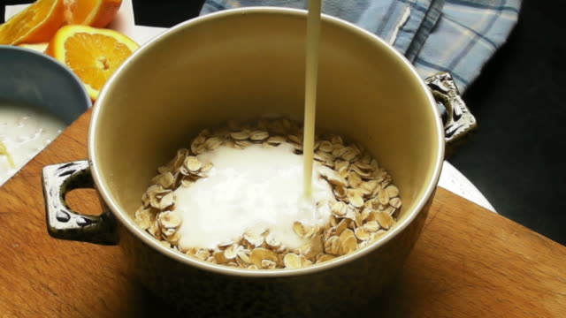 yoghurt and oatmeal - oatmeal stock videos & royalty-free footage