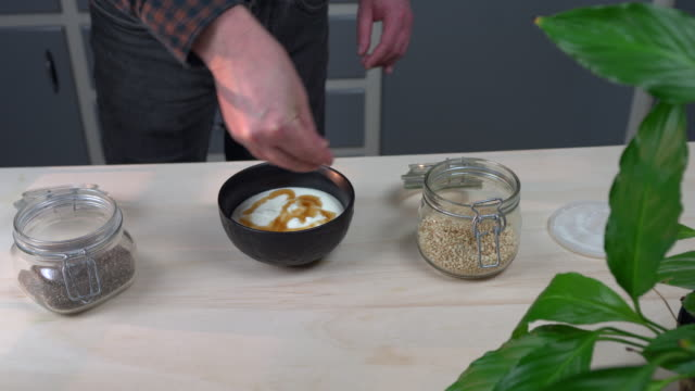 yogurt dessert preparation - maple syrup stock videos & royalty-free footage