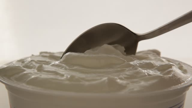 yogurt scoop - yoghurt stock videos and b-roll footage