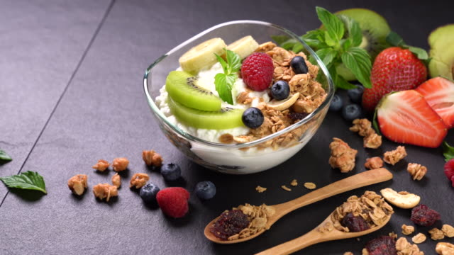yogurt with granola and fruits - yoghurt stock videos and b-roll footage