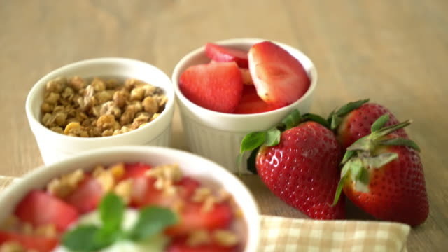 yogurt with strawberry and granola - yoghurt stock videos and b-roll footage
