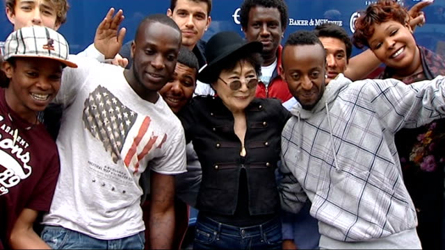 Yoko Ono curates 'Meltdown' festival Yoko Ono interview EXT Close shot Yoko Ono smiling and wearing sunglasses / Ono posing for photocall with...