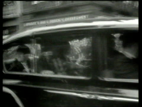 Yoko Ono denies John Lennon IRA links LIB B/W 1960s Footage GV Car containing The Beatles along street John Lennon speaking during interview with The...
